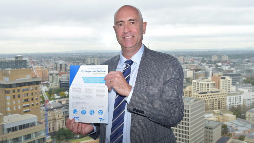 Photo of Stuart Moseley holding the summary of the VPA Strategic Priorities 2019-2020